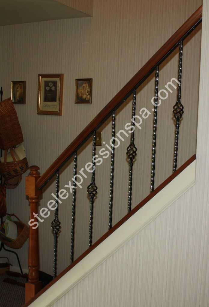 Custom Wrought Iron insert into wood Handrailing